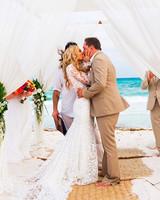 celebrity-wedding-moments-jason-aldean-brittany-kerr-kiss-1215.jpg