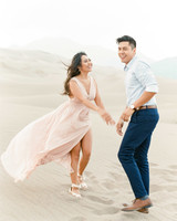 destination engagement couple walking sand dunes colorado
