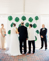 Green leaf on white wall altar