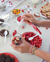 retro-ice-cream-parlor-bridal-shower-guest-adding-toppings-0815.jpg