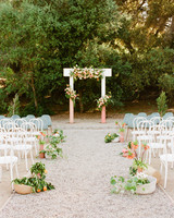 Tenley molzahn taylor leopold wedding ceremony flowered arch