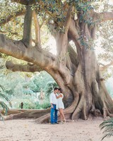 destination engagement couple botanical garden large tree
