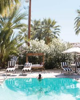 travel-honeymoon-diaries-poolside-palm-trees-palm-springs-s112941.jpg