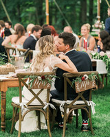 vanessa steven wedding couple kiss chairbacks