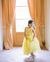 flower girl wearing yellow dress