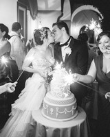 couple kissing by cake and sparklers