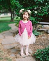 flower girl wearing pink cardigan tutu and flower crown