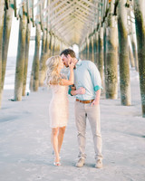 destination engagement under dock couple kiss