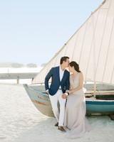 peony-richard-wedding-maldives-couple-by-sailboat-sand-kiss-0632-s112383.jpg