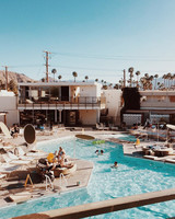 bachelorette cities palm springs pool view with palm trees