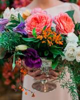 seasonal-fall-flowers-asclepias-orange-woman-holding-arrangement-opener-1115.jpg