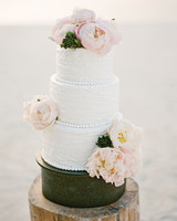 Three Tiered White Wedding Cake With Blush Peonies And Icing Beading