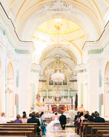 Bride, Groom, and Guests Sitting in Church