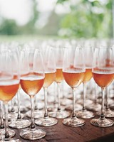 stephanie-mike-wedding-north-carolina-rose-champagne-glasses-cocktail-hour-63-s112048.jpg