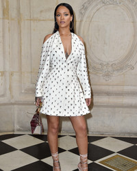 Rihanna Shuts Down Paris Fashion Week in a Wedding-Worthy Dress