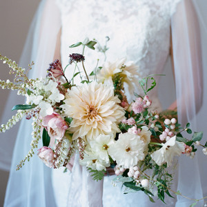 bride holding floral wedding bouquet
