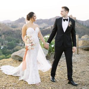 Bride and groom walking together outside