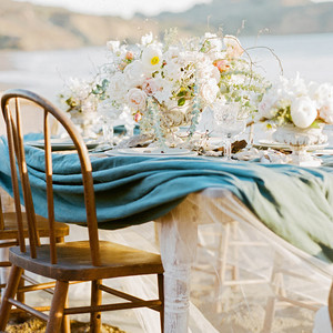 tulle underneath blue linen on beachside table