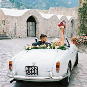 allie and joe italy wedding couple in vintage getaway car