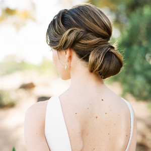 bride low bun hairstyle spiral volume