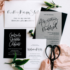 black white invitation suite with calligraphy