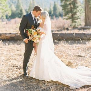 alexandra david wedding couple portrait in field with mountain view