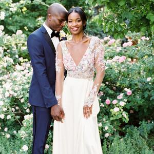 bride wearing sheer long sleeve wedding dress