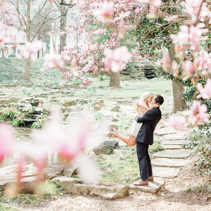 couple engagement embrace with pink flowers