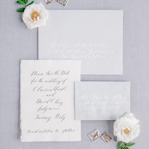 classic save the dates deckled edges calligraphy