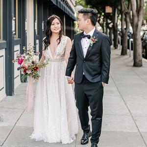 stephanie tim wedding walking on sidewalk