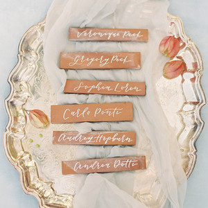 terra cotta decor name cards on a decorative plate