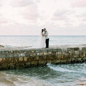 abbey jeffrey wedding couple kiss on stone pier
