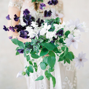 bouquet with purple and white flowers and greenery
