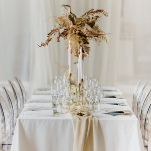 non-floral wedding centerpieces gold candle sticks and dried leaves