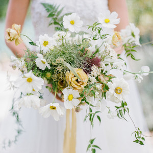 yellow florals mixed with greenery accents bouquet