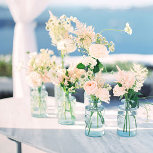 pink roses and white flowers in glass vases