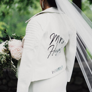 white leather jacket with painted name and numerals