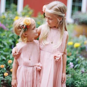 two flower girls wearing pink dresses