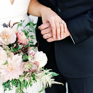 julianne aaron wedding couple hands rings