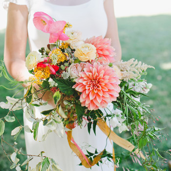 bride with dahlia bouquet orange yellow white