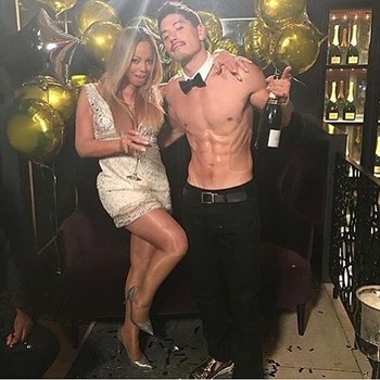 Mariah Carey and Bryan Tanaka
