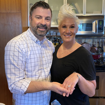 anne burrell stuart claxton engaged posing with ring