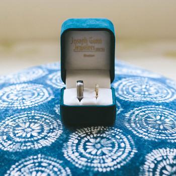 bride groom wedding bands in blue box