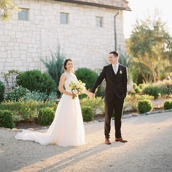 bride groom wedding day pose outside vineyard