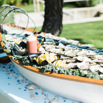 boat shaped serving tray filled with seafood