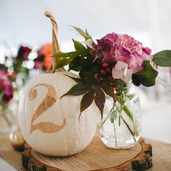 mason jar flower holder with pumpkin table number