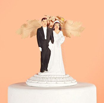 vintage wedding couple with foliage cake topper