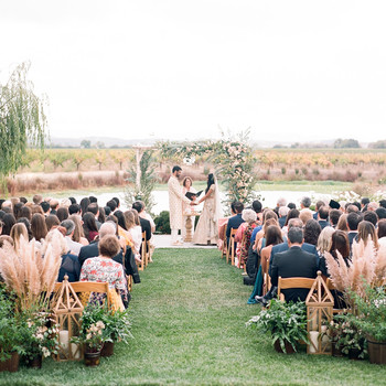 bride and groom exchange vows during outdoor wedding ceremony