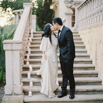emme daji wedding couple kissing on staircase