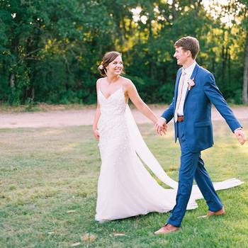 evie joe wedding couple holding hands walking